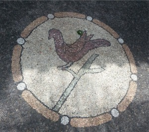 Bird mosaic at the entrance to a home.